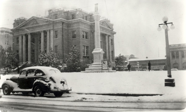 The Old Alexandria, Louisiana City Hall under a cover of snow...1930s